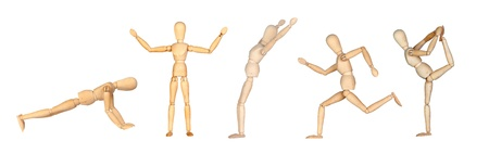Jointed wooden mannequin doing different positions isolated on white background photo