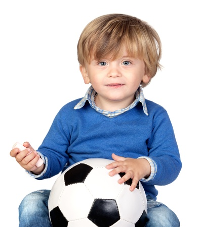 Beautiful baby with a soccer ball isolated on white background photo