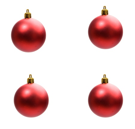 Four red balls of christmas isolated on a over white background photo