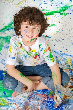 Adorable boy playing with the background painted Stock Photo