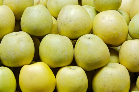 Stacked green apples in a store of fruits Stock Photo - 13354434