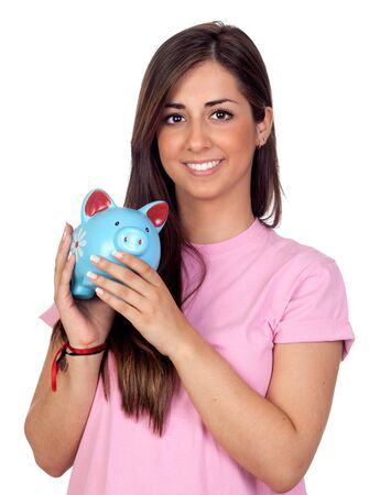 Atractive girl with a blue piggy-bank isolated on white background photo