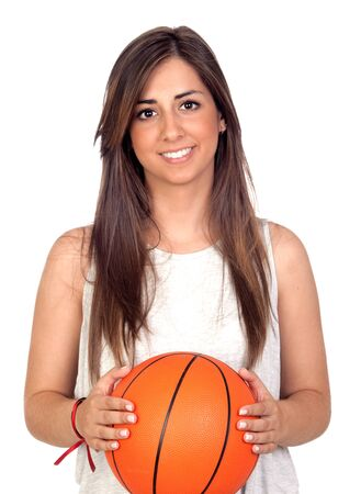 Atractive girl with a basketball ball isolated on white background photo
