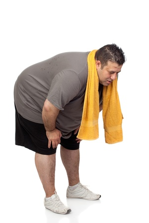 body pain: Fat man playing sport isolated on a white background Stock Photo