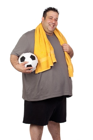 morbidity: Fat man with a soccer ball isolated on a white background Stock Photo