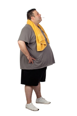 Fat man playing sport and smoking isolated on a white background photo