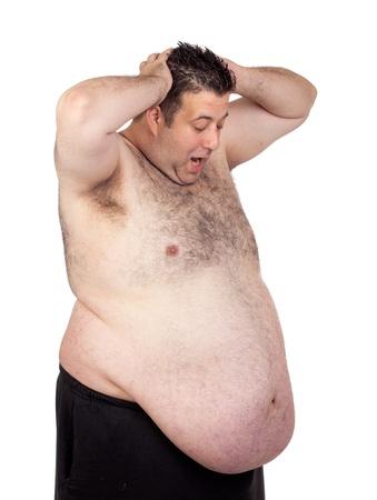 uomo nudo: Sorpreso uomo grasso isolato su sfondo bianco