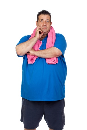 unhealthy thoughts: Pensive fat man playing sport isolated on a white background