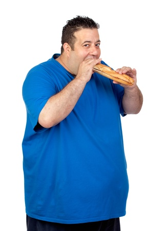 morbidity: Happy fat man eating a large bread isolated on white background