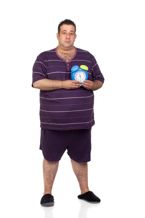 morbidity: Fat man with a blue alarm clock isolated on white background