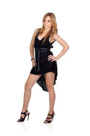 Teen rebellious girl with a black dress isolated on a over white background photo