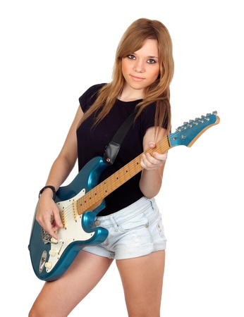 Teen rebellious girl playing electric guitar isolated on a over white background photo