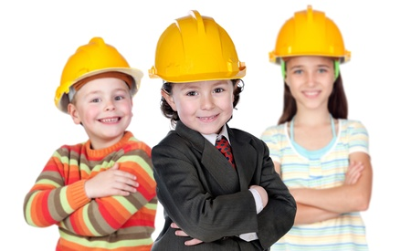 construction safety: Three future construction workers isolated on a over white background
