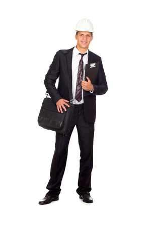 Successful young business man carrying a suitcase on white background photo
