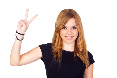 Young Girl Making a Victory Sign with Her Hands Isolated on White photo