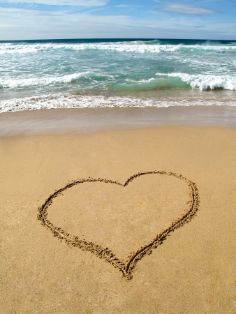 Waves breaking on shore and a heart painted Stock Photo - 15774949
