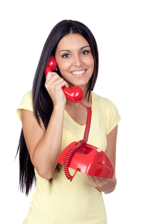 Attractive brunette girl calling with red phone isolated on white background photo