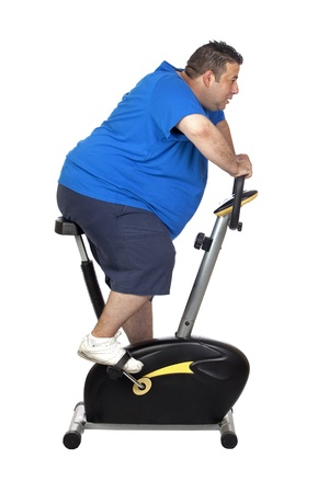 Fat man playing sport isolated on a white background photo