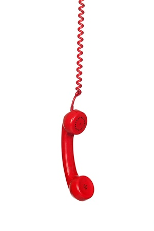 Red telephone cable hanging isolated on white background photo