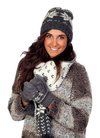 Beautiful girl dressed in winter clothing isolated on a over white photo