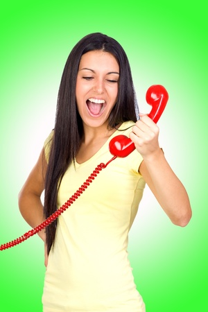 Casual Woman Shouting a Red Phone with Green background photo