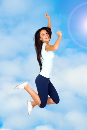 Happy Sporty Girl Flying with clouds background photo