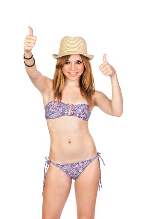 Young Casual Girl with Bikini making an OK Sign with hands isolated on white Stock Photo - 16220686