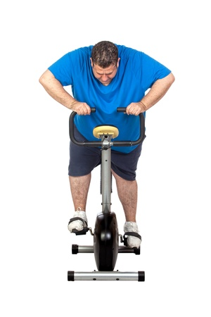 single man: Fat Man in a Static Bicycle on a White Background