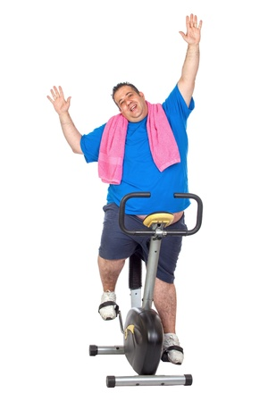 Fat Man in a Static Bicycle on a White Background photo