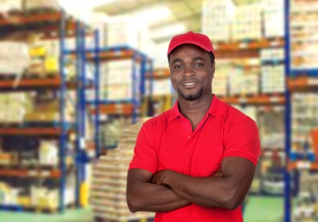 Worker man with red uniform in his workplace photo