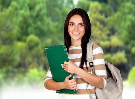 Attractive student girl in the Campus with many trees Stock Photo - 16523317