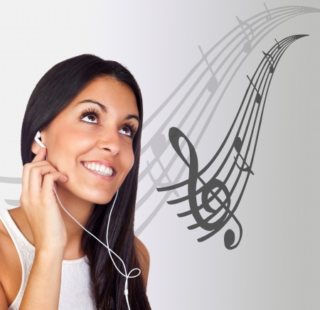 musical score: Casual Young Girl Listening Music with background musical score Stock Photo