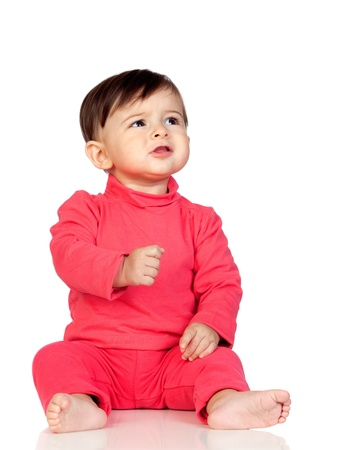 frowned: Adorable baby girl frowning isolated on white background
