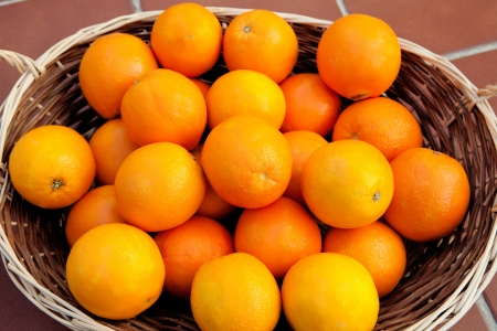 glowing skin: Basket full of oranges with a glowing skin Stock Photo
