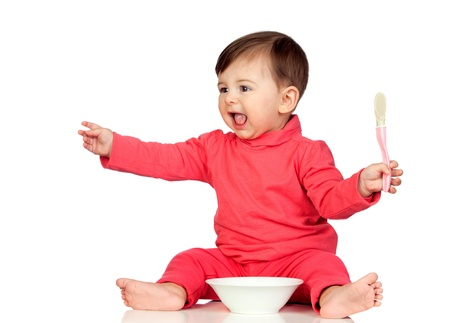 Hungry baby girl yelling for food isolated on white background photo