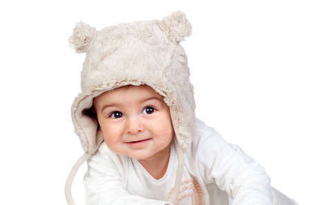 Adorable baby girl with a funny bear hat isolated on white background photo