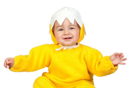 Adorable baby girl with chicken costume isolated on white background photo