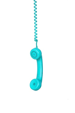 Turquoise telephone cable hanging isolated on white background photo