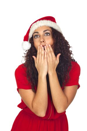 Beautiful woman surprised in Christmas isolated on white background photo