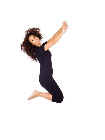 Happy Brunette Woman Jumping Isolated on White photo