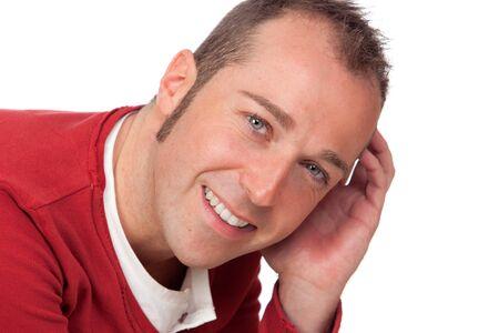 sympathetic: Sympathetic man smiling isolated on white background