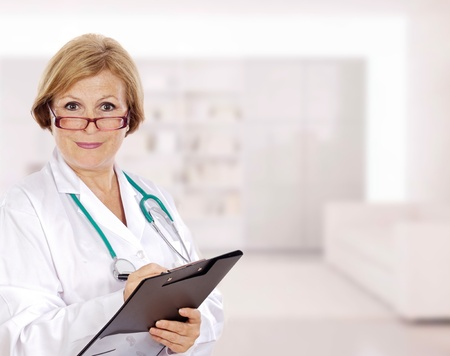 Senior doctor woman with a clipboard in the hospital