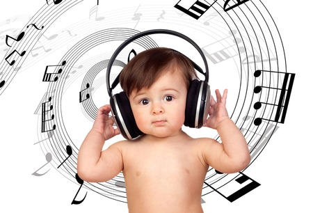 Baby girl listening music and surrounded with a spiral of musical notes photo