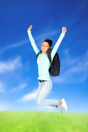 Young Girl Jumping with a blue sky background photo
