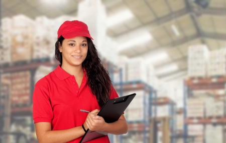 Young worker with red uniform and clipboard at work photo