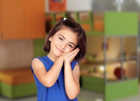 Brunette little girl in her bedroom photo