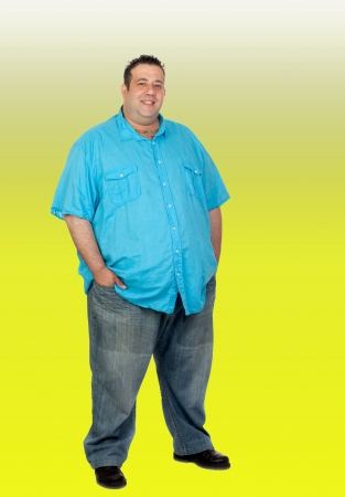 potbelly: Happy fat man with blue shirt isolated with a green background