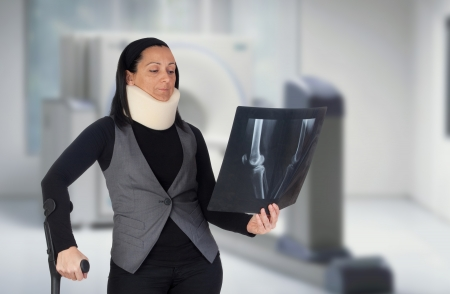 Woman with cervical collar and radiography in the hospital photo