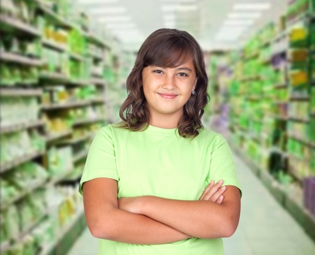 Adorable preteen girl in the market photo