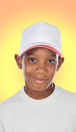 Adorable African boy a with a yellow background photo